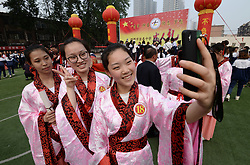 April 27, 2018 - Handan, Handan, China - Handan, CHINA-27th April 2018: Students wearing traditional Chinese clothes attend the coming-of-age ceremony at Fuchun Middle School in Handan, north China's Hebei Province, April 27th, 2018, expressing their love toward their parents. (Credit Image: © SIPA Asia via ZUMA Wire)