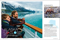 Spread in AAA Journey Magazine's March-April 2019 issue. <br /> Couple enjoy the scenery of Glacier Bay National Park (Grand Pacific Glacier in background) aboard the Un-Cruise ship Wilderness Explorer, southeast Alaska USA.