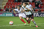 Fara Williams (England) and Lorca Van De Putte (Belgium) race to get to the ball during the Euro 2017 qualifier between England Ladies and Belgium Ladies at the New York Stadium, Rotherham, England on 8 April 2016. Photo by Mark P Doherty.