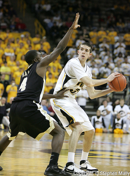 26 NOVEMBER 2007: Iowa guard Jake Kelly (32) tries to pass the ball around Wake Forest guard Harvey Hale (4) in Wake Forest's 56-47 win over Iowa at Carver-Hawkeye Arena in Iowa City, Iowa on November 26, 2007.