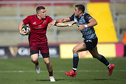 September 30, 2017 - Limerick, Ireland - Andrew Conway of Munster tackled by Steven Shingler of Cardiff during the Guinness PRO14 Conference A Round 5 match between Munster Rugby and Cardiff Blues at Thomond Park in Limerick, Ireland on September 30, 2017  (Credit Image: © Andrew Surma/NurPhoto via ZUMA Press)