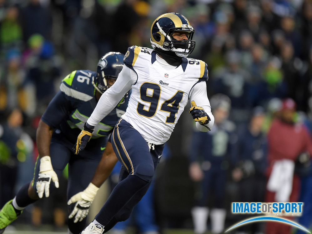 Dec 28, 2014; Seattle, WA, USA; St. Louis Rams defensive end Robert Quinn (94) tries to get past Seattle Seahawks left tackle Russell Okung (76) at CenturyLink Field. he Seahawks defeated the Rams 20-6 to clinch the NFC West division title.