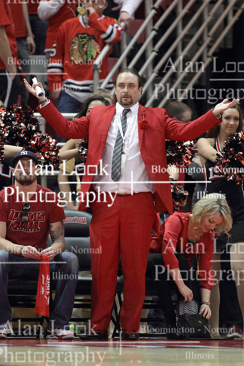 """14 February 2015:   A Redbird super fan with a curtsied seat wearing a red suit complete with red slacks and a red rose stands and asks """"What"""" as an official makes a call during an NCAA MVC (Missouri Valley Conference) men's basketball game between the Wichita State Shockers and the Illinois State Redbirds at Redbird Arena in Normal Illinois"""