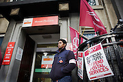 Members of the Communication Workers Union (CWU) occupy an official picket line outside the sorting office at Mount Pleasant  while staging their nationwide two-day strike.