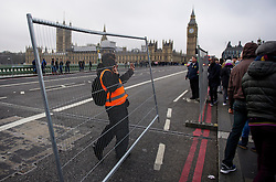© Licensed to London News Pictures. 31/12/2016. London, UK. Barriers being put in place to close off Westminster Bridge in  London ahead of tonight's New Year celebrations. Security surrounding this year's event has been heightened following a terrorist attack at a Christmas market in Berlin earlier this month. Photo credit: Ben Cawthra/LNP