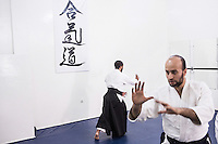CASABLANCA, MOROCCO - 14 MAY 2016: (R-L) Brothers Ali (32) and Ahmed (28) Abdul Hakeem teach aikido to a class of students in the dojo their father Luqman founded after moving to Morocco in 1985, in Sidi Maarouf, a district of Casablanca, Morocco, on May 14th 2016.<br /> <br /> The Hakeem brothers are the sons of Luqman Abdul-Hakeem, a close follower of Malcolm X that chauffeured the African American activist around and introduced him to Cuban leader  Fidel Castro in September 1960.<br /> <br /> Born in Cleveland, OH, in 1934, Luqman Abdul-Hakeem was raised in Flushing, Queens, and then moved to Bayside, where he graduated in 1952. He attended the New York Technical University for a few months before enrolling in the Navy, where he stayed for two years. Though he had asked for ship duty, he ended up in Springfield, Mass., and Glennclose, Ill. He moved to Brooklyn when his hitch was done and by 1966 was studying jujitsu and aikido. He met Malcolm X during one of his sermons on 116th street in Harlem, New York, in the late 50's. In 1985, Mr. Hakeem decided to move to Marocco because America wasn't a country where he wanted to raise hois children. He has been teaching aikido in the two dojos he owns in Casablanca until 2014, when he underwent a surgery.