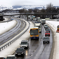 Lorries and cars queueing as far as the eye can see on the southbound M90 at Junction 5 near Cleish in Perthshire after snow caused traffic chaos. The northbound carriageway is deserted as the motorway was closed and blocked.<br />