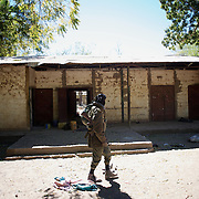 January 21, 2013 - Diabaly, Mali: Mali army men patrol a military base in central Diabaly, a day after Mali government troops regain control of the city. Diabaly was under islamist militants control since the 14th of January.<br /> <br /> Several insurgent groups have been fighting a campaign against the Malian government for independence or greater autonomy for northern Mali, an area known as Azawad. The National Movement for the Liberation of Azawad (MNLA), an organisation fighting to make Azawad an independent homeland for the Tuareg people, had taken control of the region by April 2012.<br /> <br /> The Malian government pledge to the French army to help the national troops to stop the rebellion advance towards the capital Bamako. The french troops started aerial attacks on rebel positions in the centre of the country and deployed several hundred special forces men to counter attack the advance on the ground. (Paulo Nunes dos Santos/Polaris)