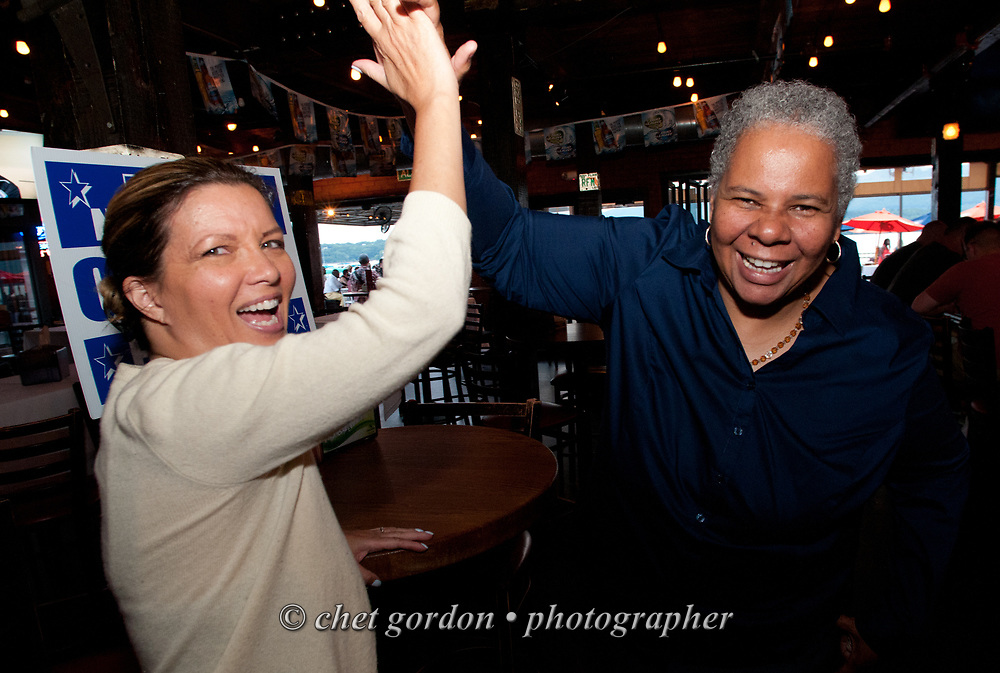 City of Newburgh Councilwoman Gay Lee (right) with supporter during a fundraiser at Billy Joe's Ribworks in Newburgh, NY on Thursday, June 25, 2015. Lee has begun her campaign bid for Mayor of Orange County's largest city against incumbent Mayor Judy Kennedy, and Jonathan Jacobson, the current Newburgh Democratic Committee Chairman.  © Chet Gordon • Photographer