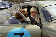 Aston Martin enthusiast Wolfgang Friedricks goes over some last minute strategy before racing in his extremely rare 1963 DP214 project car at Silverstone England. Part of the Historic racing series.
