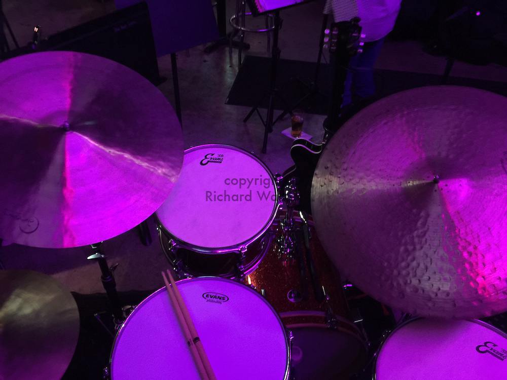 2016 NOVEMBER 20 - Drum set with cymbals in a bar in Seattle WA, USA. By Richard Walker