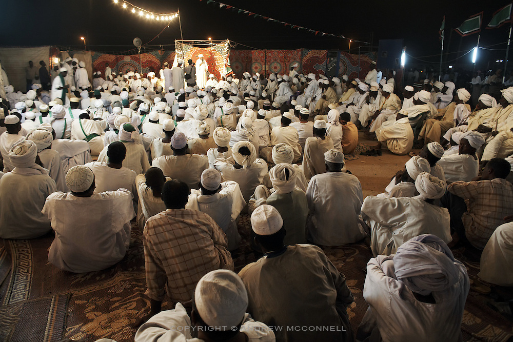Celebrating the Prophet's birthday, a sheikh preaches to members of his tariqa (sufi order), pictured in Shendi, Sudan, on Thursday, March 29, 2007. Sufism plays an important role in Sudan, sufis believe a mystical path exists by which to reach God, something which has led orthodox Islam to proclaim Sufi practices heretical.