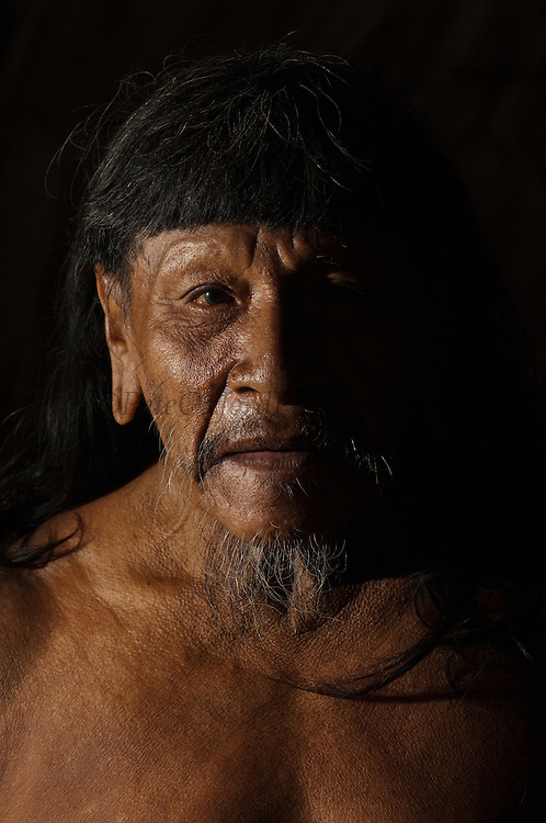 Huaorani man, Ahua Baiwa.<br /> Bameno Community. Yasuni National Park.<br /> Amazon rainforest, ECUADOR.  South America<br /> This Indian tribe were basically uncontacted until 1956 when missionaries from the Summer Institute of Linguistics made contact with them. However there are still some groups from the tribe that remain uncontacted.  They are known as the Tagaeri &amp; Taromenane. Traditionally these Indians were very hostile and killed many people who tried to enter into their territory. Their territory is in the Yasuni National Park which is now also being exploited for oil.