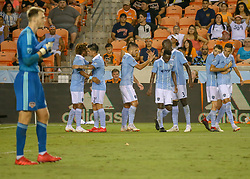 August 4, 2018 - Houston, TX, U.S. - HOUSTON, TX - AUGUST 04:  Sporting Kansas City forward Diego Rubio (11) is congratulated by teammates after scoring a goal with an assist by Sporting Kansas City forward Gianluca Busio (13) during the soccer match between Sporting Kansas City and Houston Dynamo on August 4, 2018 at BBVA Compass Stadium in Houston, Texas.  (Photo by Leslie Plaza Johnson/Icon Sportswire) (Credit Image: © Leslie Plaza Johnson/Icon SMI via ZUMA Press)