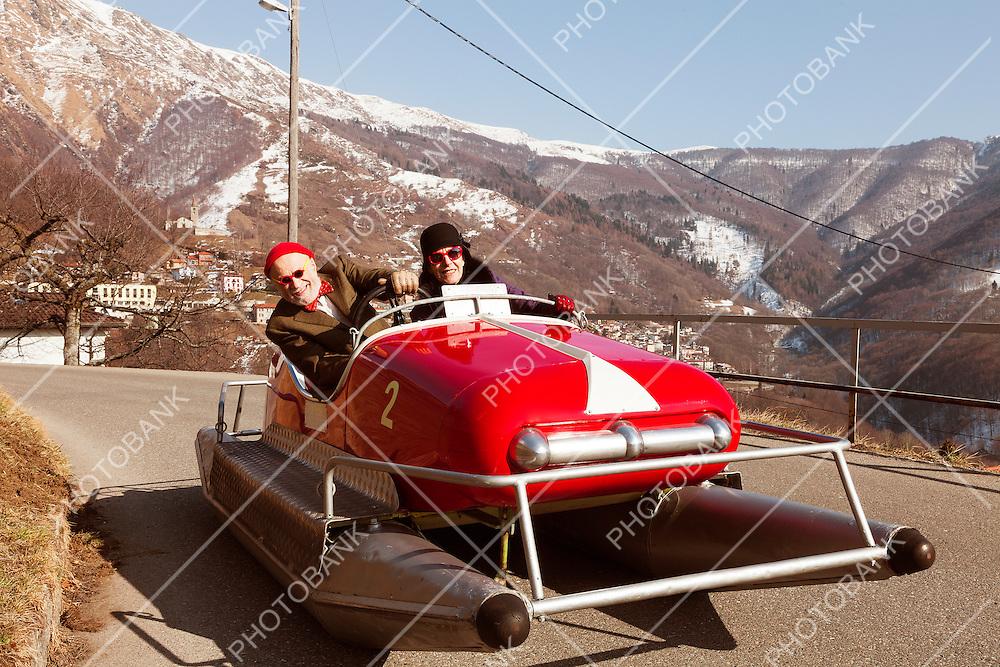 aged couple into a pedalo