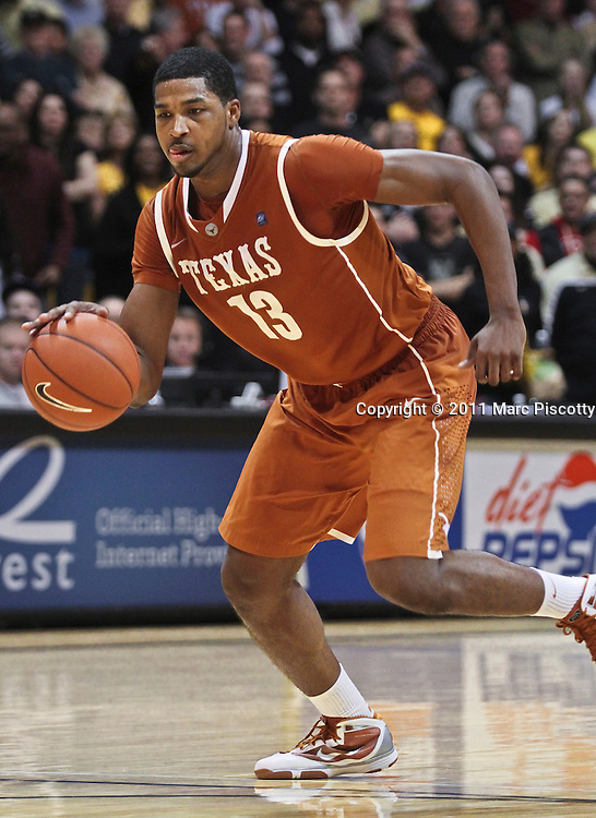 SHOT 2/26/11 4:18:24 PM - Texas' Tristan Thompson (#13) drives the lane against Colorado during their regular season Big 12 basketball game at the Coors Events Center in Boulder, Co. Colorado upset the fifth ranked Texas 91-89. (Photo by Marc Piscotty / © 2011)