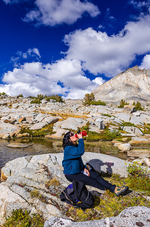 Hiker staying hydrated in Dusy Basin, Kings Canyon National Park, California USA