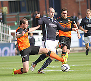 Dundee United's Callum Morris tackles Dundee's Gary Harkins - Dundee v Dundee United, SPFL Premiership at Dens Park<br /> <br />  - &copy; David Young - www.davidyoungphoto.co.uk - email: davidyoungphoto@gmail.com