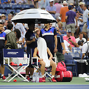 Simona Halep, Romania, during a rain delay against Victoria Azarenka, Belarus, in the Women's Singles Quarterfinals match during the US Open Tennis Tournament, Flushing, New York, USA. 9th September 2015. Photo Tim Clayton