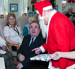 First Minister Alex Salmond, accompanied by Santa Clause (Arthur Martin), visited the Dean Club in Stiockbridge Edinburgh today to distribute Christmas presents to the residents.  (c) GER HARLEY | StockPix.eu
