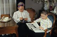 Therese at home with her grand sohn  Paris  France    coiffure sculpture du coiffeur plasticien Jean Philippe Pages .Therese dans son salon avec son petit fils  Paris  France  R00008/    L0006371  /  P101610