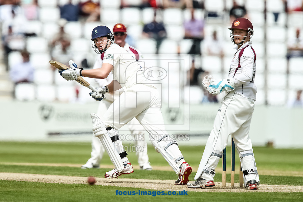 Alex Lees of Yorkshire County Cricket Club (left) plays a shot past Ben Duckett of Northamptonshire County Cricket Club (right) during the LV County Championship Div One match at the County Ground, Northampton, Northampton<br /> Picture by Andy Kearns/Focus Images Ltd 0781 864 4264<br /> 01/06/2014