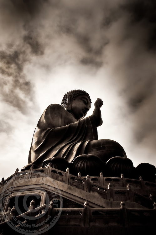 The serene Tian Tan Buddha on Lantau Island, Hong Kong. This is one of the world's tallest outdoor bronze buddhas and is reached after climbing 268 steps.
