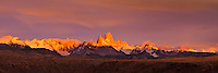 A panorama of the sunrise lighting the peaks and clouds around Mount Fitz Roy in Patagonia. El Chalten, Argentina.