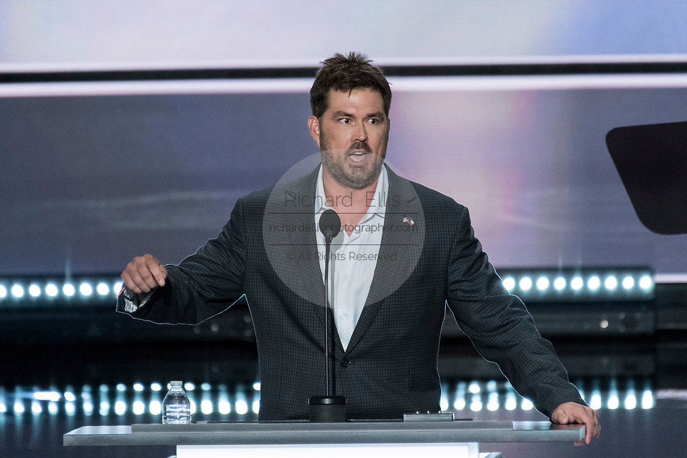 Retired Navy SEAL Marcus Luttrell addresses delegates during the first day of the Republican National Convention at the Quicken Loans Center July 18, 2016 in Cleveland, Ohio.