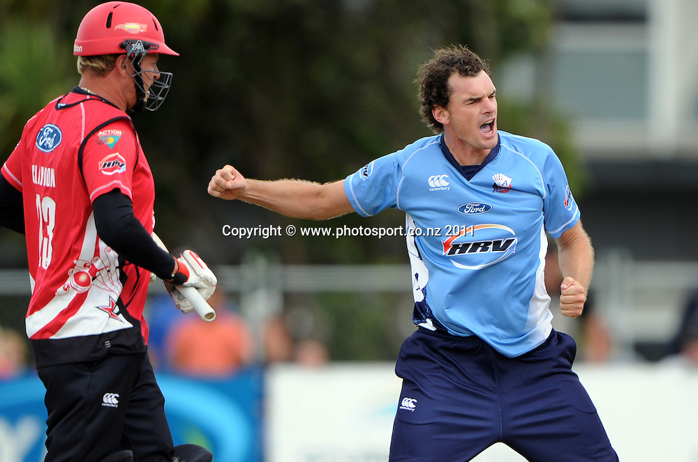 Kyle Mills celebrates winning the match as Matt Henry looks on during the HRV Twenty20 Cricket Final between the Auckland Aces and Canterbury Wizards at Colin Maiden Oval in Auckland, New Zealand on Sunday 22 January 2012. Photo: Andrew Cornaga/Photosport.co.nz