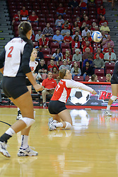 07 September 2011: Jenny Menendez crouches to gather the ball during an NCAA volleyball match between the Leathernecks of Western Illinois  and the Illinois State Redbirds at Redbird Arena in Normal Illinois.
