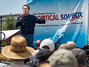 08 AUGUST 2019 - DES MOINES, IOWA: STEVE BULLOCK, the Democratic Governor of Montana, speaks at the Des Moines Register Political Soapbox at the Iowa State Fair. Gov. Bullock, his wife, Lisa Bullock, and their children went to the Iowa State Fair Thursday. Gov. Bullock spoke at the Des Moines Register Political Soapbox and then toured the fairgrounds with his family. Gov. Bullock is vying to be the party's Presidential nominee in 2020. Iowa traditionally hosts the the first election event of the presidential election cycle. The Iowa Caucuses will be on Feb. 3, 2020.       PHOTO BY JACK KURTZ