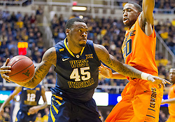 West Virginia Mountaineers forward Elijah Macon (45) drives to the basket against the Oklahoma State Cowboys during the first half at the WVU Coliseum.