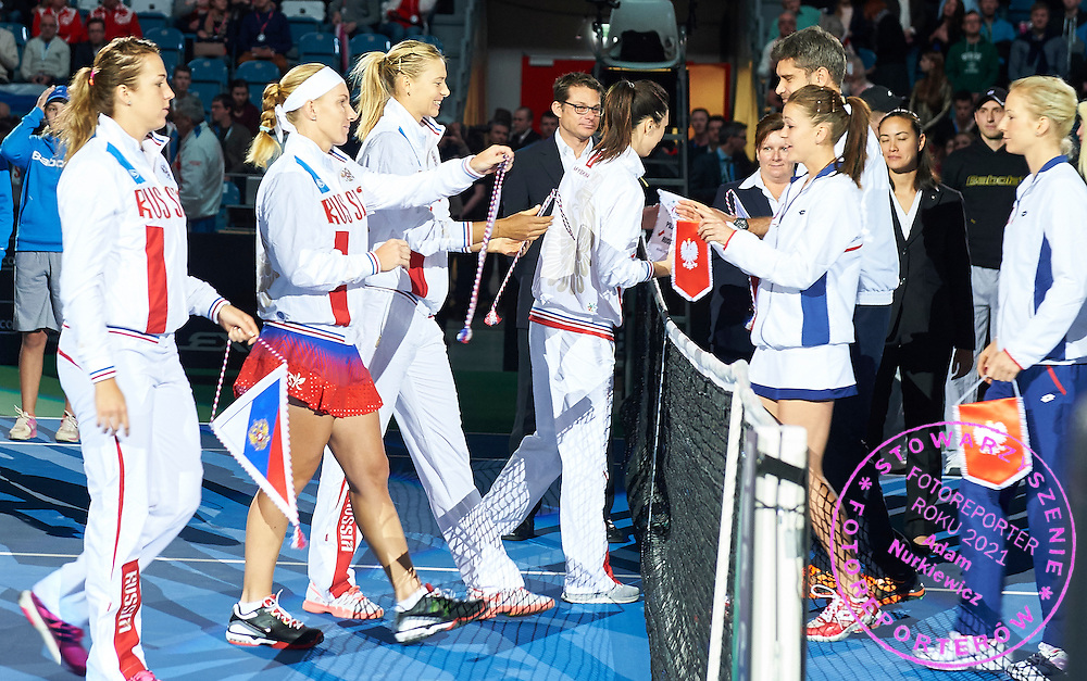 (L-R) Anastasia Pavyuchenkova and Svetlana Kuznetsova and Maria Sharapova and trainer coach Anastasia Myskina all from Russia and Agnieszka Radwanska and trainer coach Tomasz Wiktorowski  and Urszula Radwanska all from Poland during First Day of the Fed Cup / World Group 1st round tennis match between Poland and Russia at Tauron Krakow Arena on February 7, 2015 in Cracow, Poland.<br /> <br /> Poland, Cracow, February 7, 2015<br /> <br /> Picture also available in RAW (NEF) or TIFF format on special request.<br /> <br /> For editorial use only. Any commercial or promotional use requires permission.<br /> <br /> Adam Nurkiewicz declares that he has no rights to the image of people at the photographs of his authorship.<br /> <br /> Mandatory credit:<br /> Photo by &copy; Adam Nurkiewicz / Mediasport