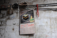 A calendar depicting the Kaaba during the Hadj, the annual pilgrimage to Mecca. Lahore, Pakistan, 2009