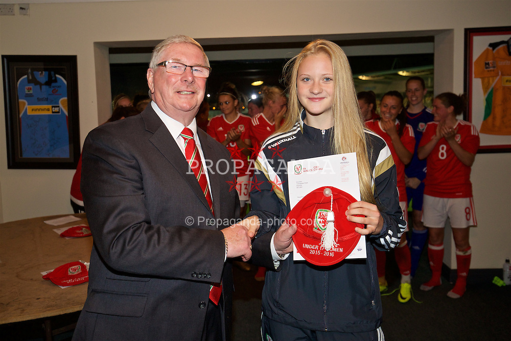 CARDIFF, WALES - Friday, August 19, 2016: Wales' Evie Gane is presented with her Under-17 cap by FAW President David Griffiths at Rodney Parade. (Pic by David Rawcliffe/Propaganda)
