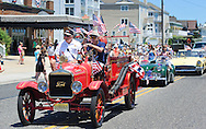 An old time fire truck is driven during the Independence Parade Saturday July 2, 2016 on Beach Avenue in Cape May, New Jersey. Photo by William Thomas Cain/Cain Images