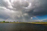A rainbow formed over Big Muddy Pond near Casper, Wyoming, during a summer thunderstorm.