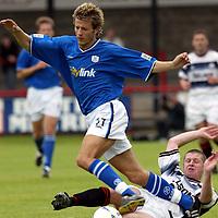 Brechin v St Johnstone....Pre-season friendly..17.07.04<br />Lee Hardy is brought down by Scott McNicoll<br /><br />Picture by Graeme Hart.<br />Copyright Perthshire Picture Agency<br />Tel: 01738 623350  Mobile: 07990 594431