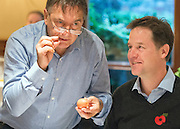 © Licensed to London News Pictures. 03/11/2014. Oxford, UK. RAYMOND BLANC (C) shows NICK CLEGG (R) how to spot if it is safe to use a raw egg in cooking.  To celebrate National School Meals Week (3-7 November), the Deputy Prime Minister, Nick Clegg, joins school children at Brasserie Blanc in Oxford to get some top cooking tips from Raymond Blanc. The visit is part of a larger national effort to raise awareness of and enhance children's relationship with food. The Deputy Prime Minister has called on celebrity chefs to lead the way by joining forces with school cooks to promote the great school lunch. School cooks up and down the country will be taking their skills out of the school kitchen to showcase to parents and pupils the variety and quality of food now being served in schools. National School Meals Week comes just months after the launch of free school meals for 2.8 million primary school children and the introduction of cooking in the curriculum.. Photo credit : Stephen Simpson/LNP