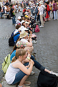 Italy, Rome, Piazza Navona Tourists enjoy a break and eat ice cream