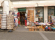 Shop displaying various tourist souvenir products on sale,  city of Evora, Alto Alentejo, Portugal, southern Europe