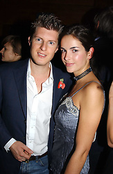 MR JEREMY SINGER and MISS OCTAVIA KHASHOGGI  at a party hosted by Tatler magazine to celebrate the publication of the 2004 Little Black Book held at Tramp, 38 Jermyn Street, London SW1 on 10th November 2004.<br />