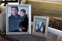 "Photographs of loved ones lost to violence at a somber mid-November ceremony in Closter Park in Salinas. The group ""A Time for Grieving and Healing"" led by Debbie Aguilar unveiled a memorial to the numerous victims of violence in Monterey County since 1988."
