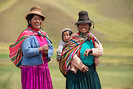 South America,Peru, two native indian women with child along the Highway from Puno to Cusco