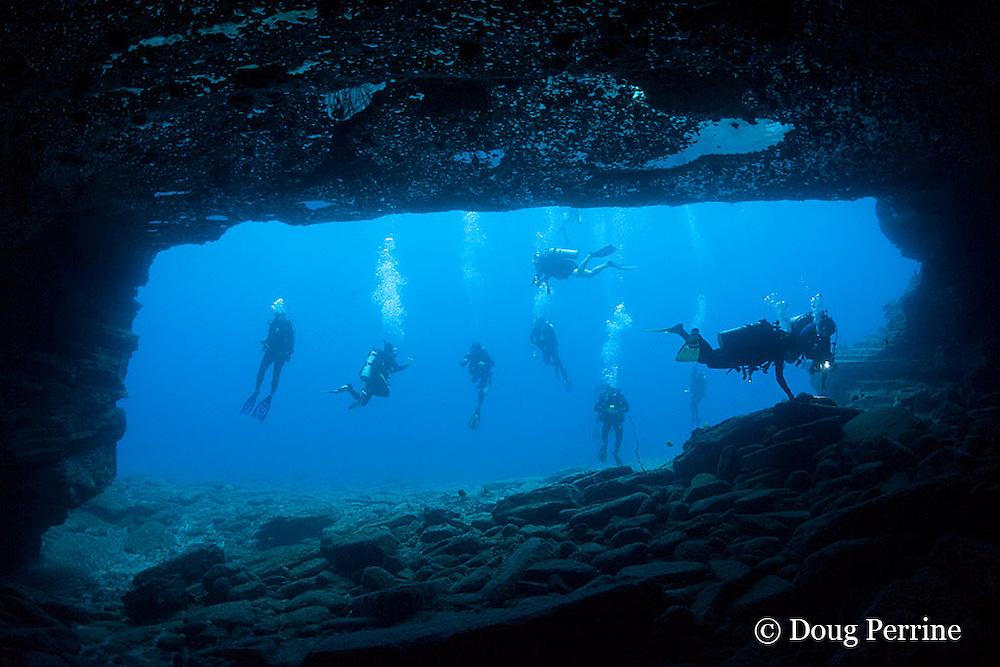 scuba divers at Niihau Arches dive site, off Niihau, Hawaii, USA ( Central Pacific Ocean )