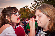 "Oct. 30, 2009 -- PHOENIX, AZ: BAILEY CURRY, left, helps ELLIE EVANS put on makeup before the Zombie Walk in Phoenix. About 200 people participated in the first ""Zombie Walk"" in Phoenix, AZ, Friday night. The Zombies walked through downtown Phoenix ""attacking"" willing victims and mixing with folks going to the theatre and downtown sports venues.  Photo by Jack Kurtz"
