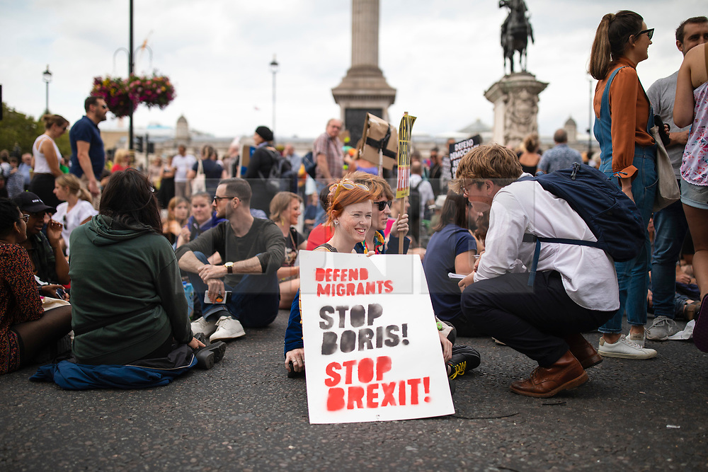 © Licensed to London News Pictures. 31/08/2019. London, UK. Demonstrators block the road by Trafalgar Square after thousands of protesters gathered outside Downing Street to protest against the suspension of Parliament. The Queen has approved Prime Minister Boris Johnson's request to prorogue Parliament shortly after MPs return to work in September, a few weeks before the Brexit deadline of 31 October. Photo credit: Rob Pinney/LNP