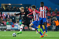 Kevin Kampl of Bayer 04 Leverkusen competes for the ball with  Vrsaljko of Atletico de Madrid during the match of Uefa Champions League between Atletico de Madrid and Bayer Leverkusen at Vicente Calderon Stadium  in Madrid, Spain. March 15, 2017. (ALTERPHOTOS / Rodrigo Jimenez)
