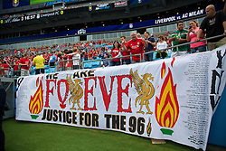 CHARLOTTE, USA - Saturday, August 2, 2014: Liverpool supporters banner 'We Are Forever Justice for the 96' before the International Champions Cup Group B match against AC Milan at the Bank of America Stadium on day thirteen of the club's USA Tour. (Pic by David Rawcliffe/Propaganda)